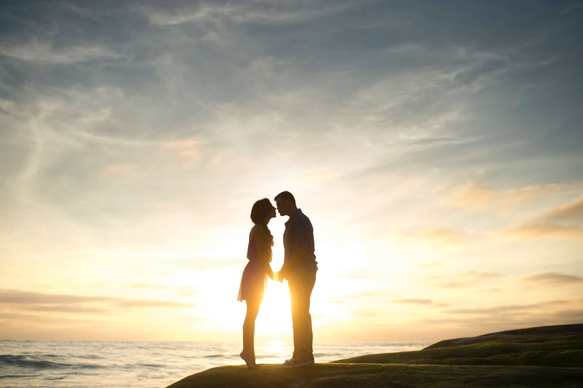 A couple kiss and see the beautiful sun set