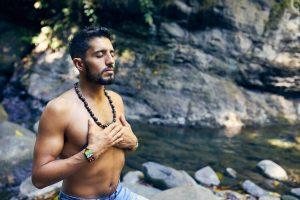 man praying spirituality vs religion